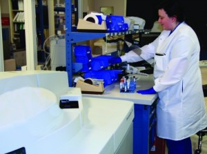 Strategic positioning of this movable workstation between two chemistry analyzers allows easy access to instruments for loading and results review. Photo courtesy Laboratory Alliance of Central New York.